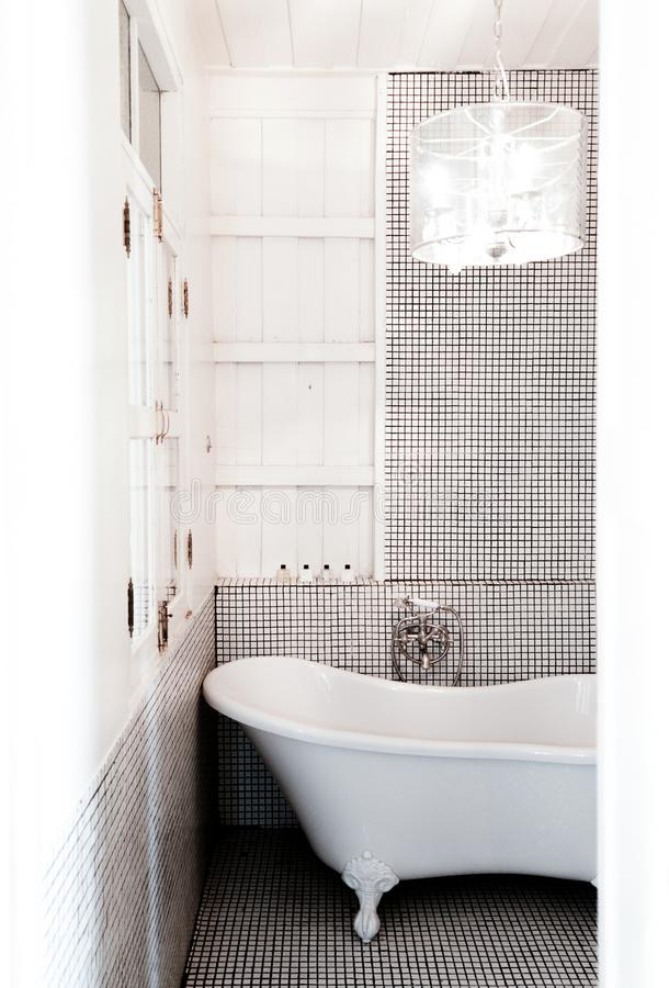 Vintage warm cozy clean style bathroom with bathtub and pedant lamp stock photo