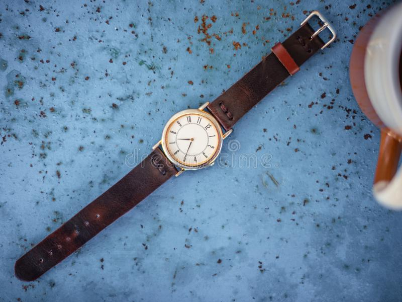 Gold/silver vintage watch with brown leather bracelet. stock photo