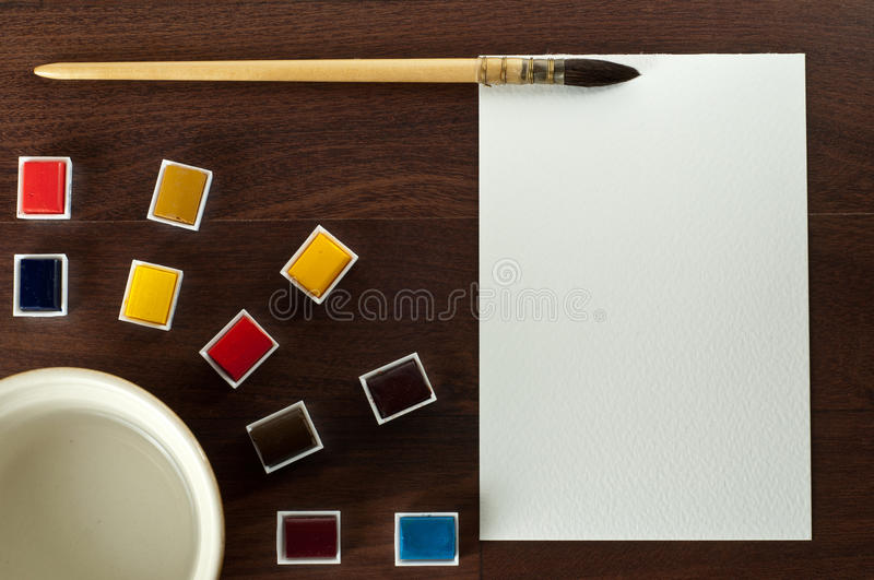 Vintage watercolor paint set with paper, water. stock photos
