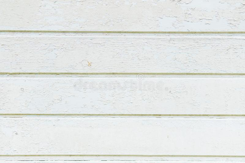 Vintage weathered shabby white painted wood texture as background. Rustic white pastel wooden plank texture.wooden wall stock images