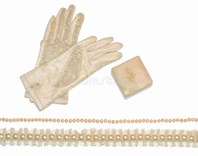 Vintage wedding accessories. Such a pair of lace gloves, pearl necklaces and a jewelry box stock image