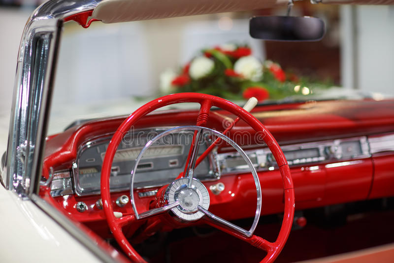 Vintage wedding car in red with bride flower bouquet stock images