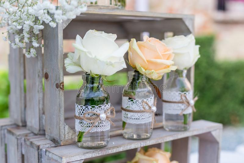 Vintage wedding decoration for wedding day. Vintage Wedding decoration, bottles with flowers, for wedding reception outdoor stock photography