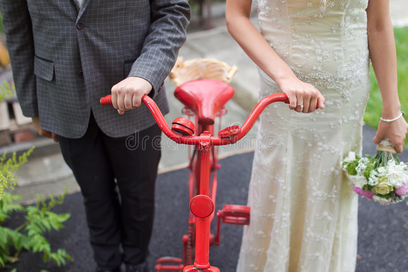 Vintage wedding. Groom and the bride with a bicycle royalty free stock photo