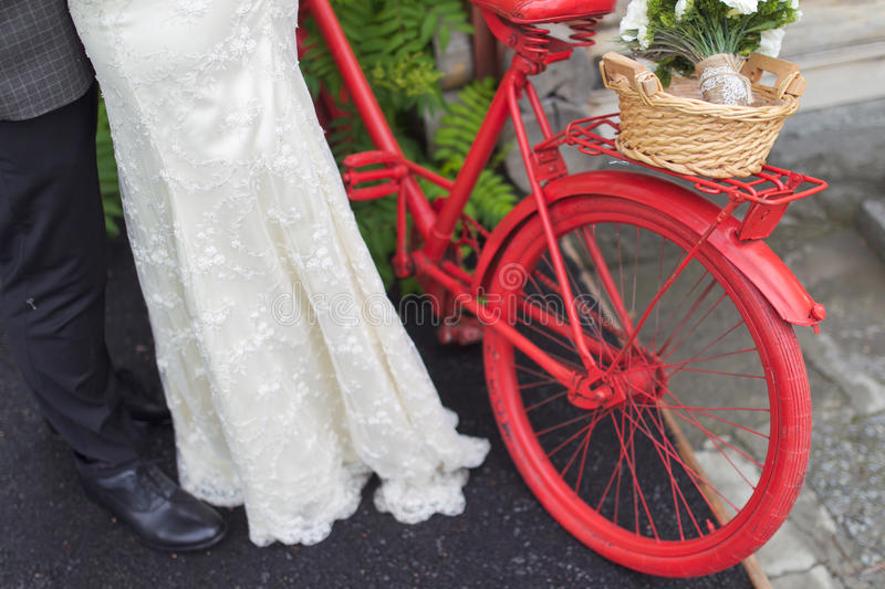 Vintage wedding. Groom and the bride with a bicycle stock image