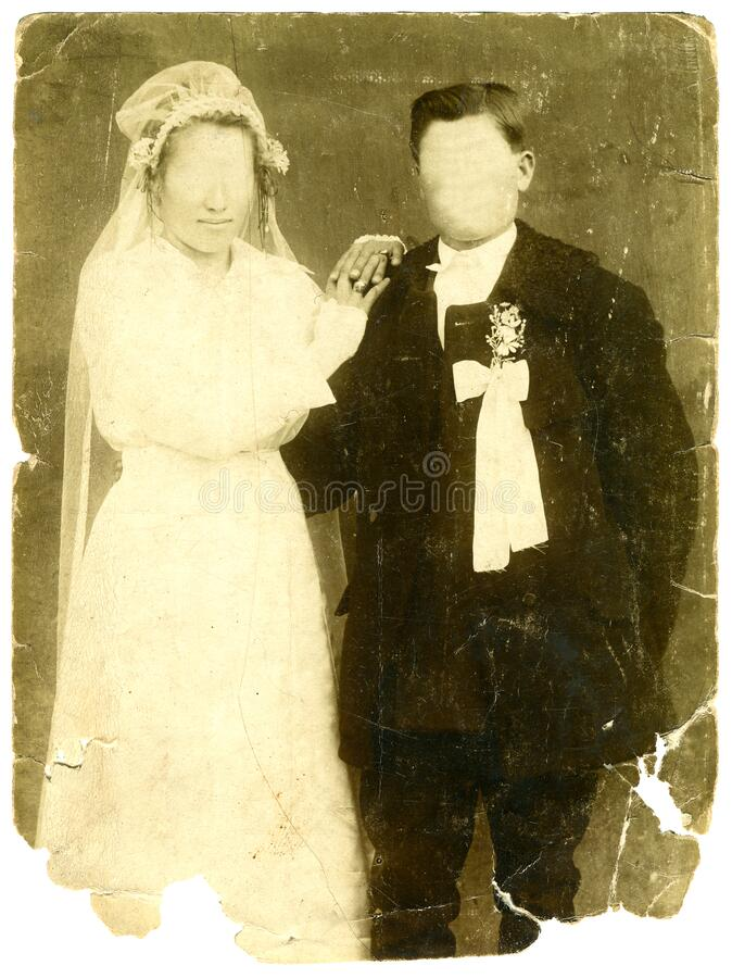 Vintage wedding photo with blank faces stock image