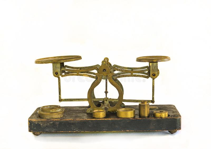 Vintage weighing scales isolated on the white stock photo