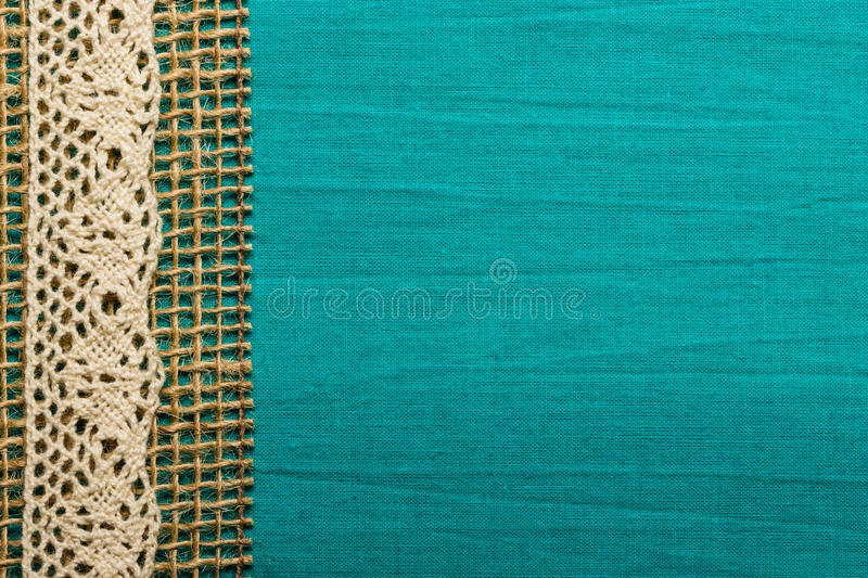 Retro Border Or Rustic Style Frame Vintage White Lace And Burlap String Over Green Blue Textile Background