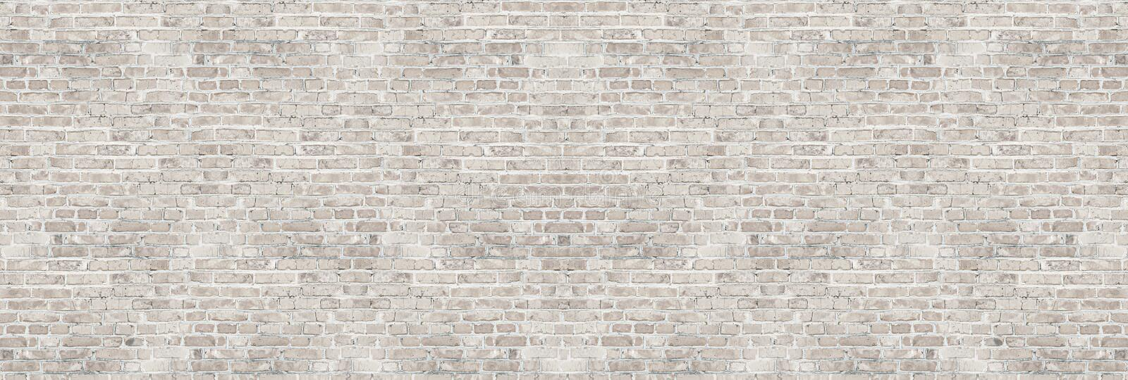 Vintage white wash brick wall texture for design. Panoramic background royalty free stock photo