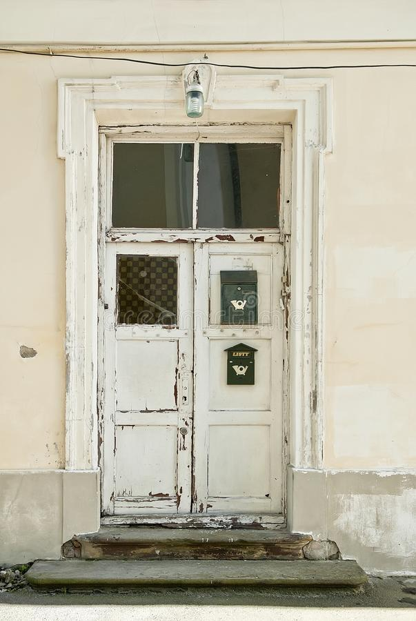 Vintage white wooden door with mailbox and lantern. Background stock photos