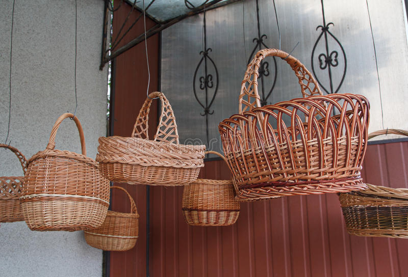 Vintage wicker baskets hanging on the market. Craft royalty free stock photo