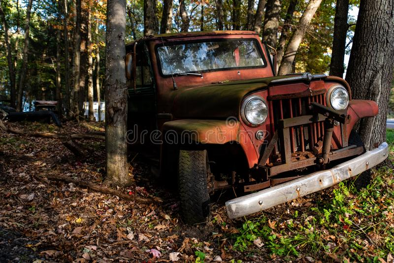 Vintage Antique Car - Junkyard in Autumn - Abandoned Willys Jeep Station Wagon - Pennsylvania stock photos