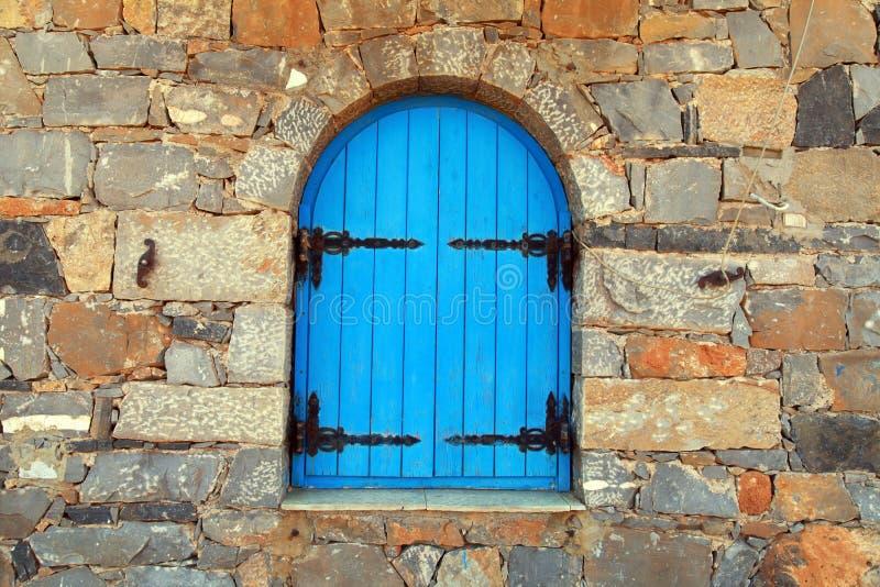 Vintage window with blue shutters,Greece.