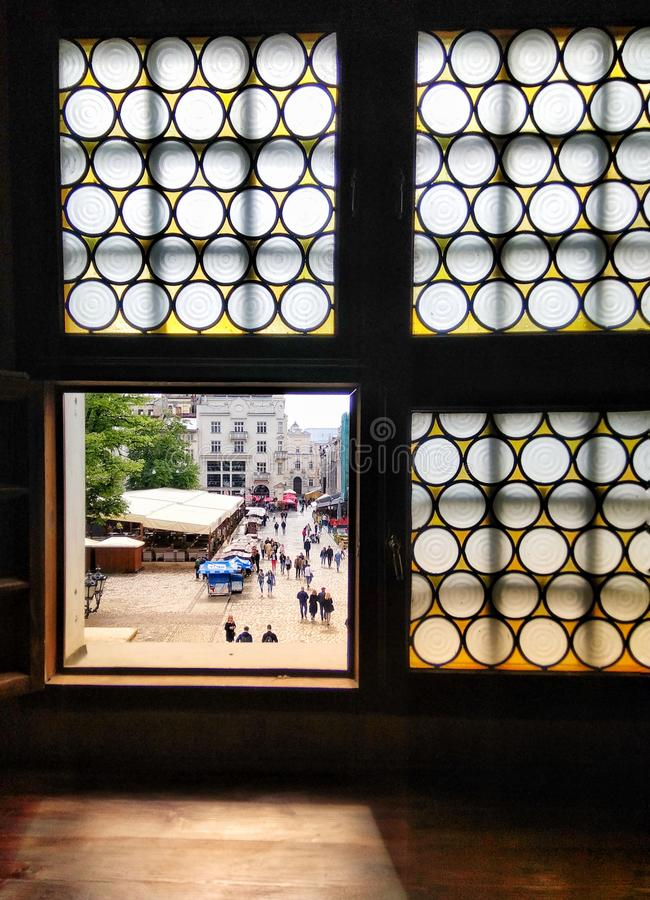 Window with a view of Market Square in Lviv, Ukraine royalty free stock photography