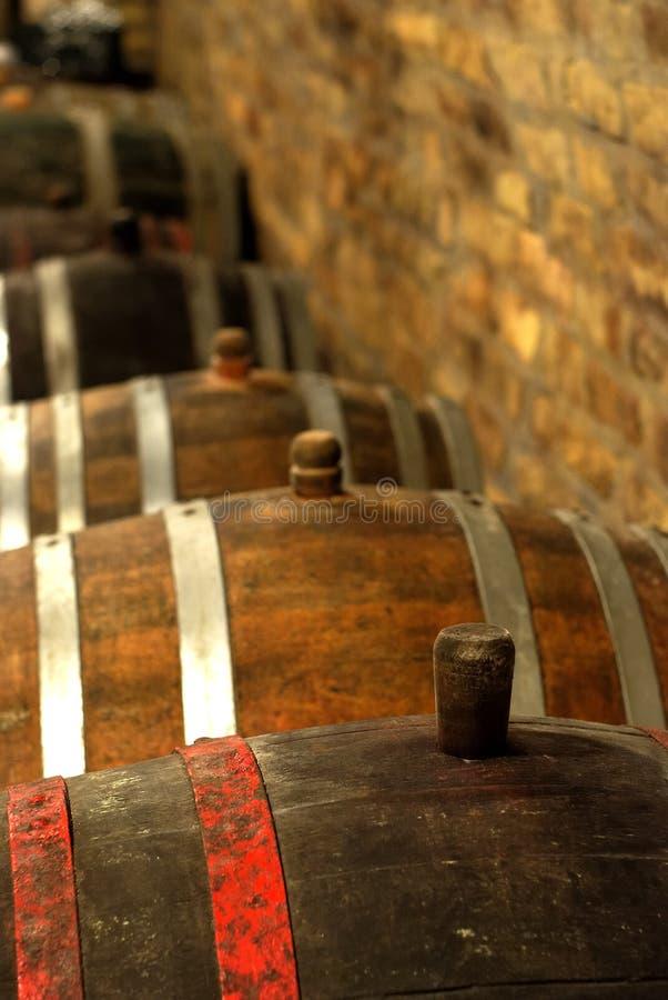 Vintage wine barrel in cellar stock photos