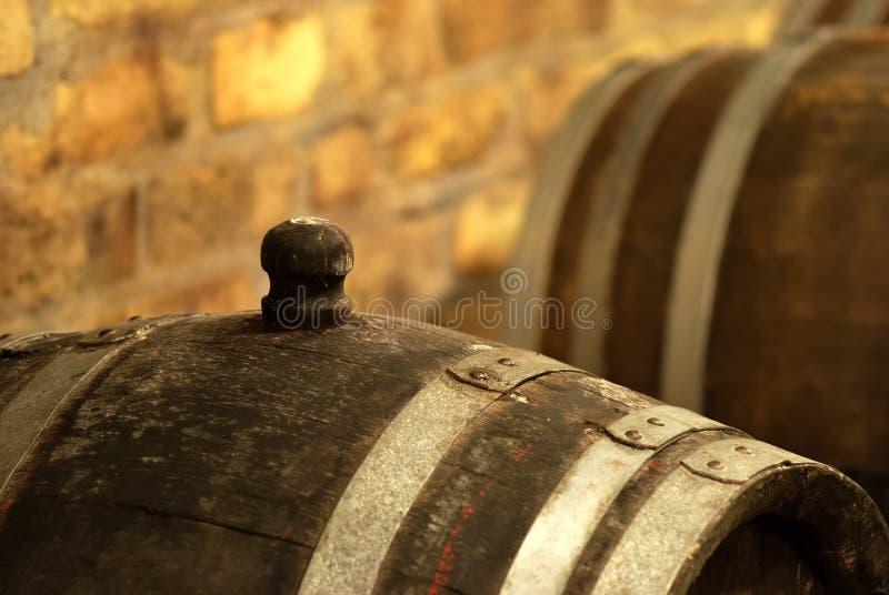 Vintage wine barrel in cellar stock photo
