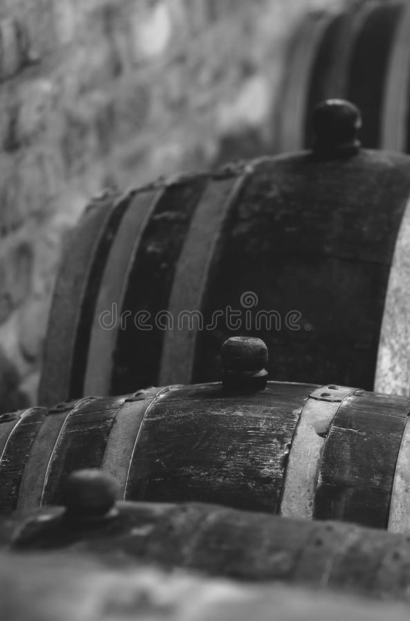 Vintage wine barrel in cellar stock photography