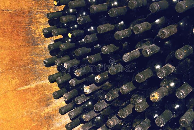 Vintage wine bottles in cellar stock photos