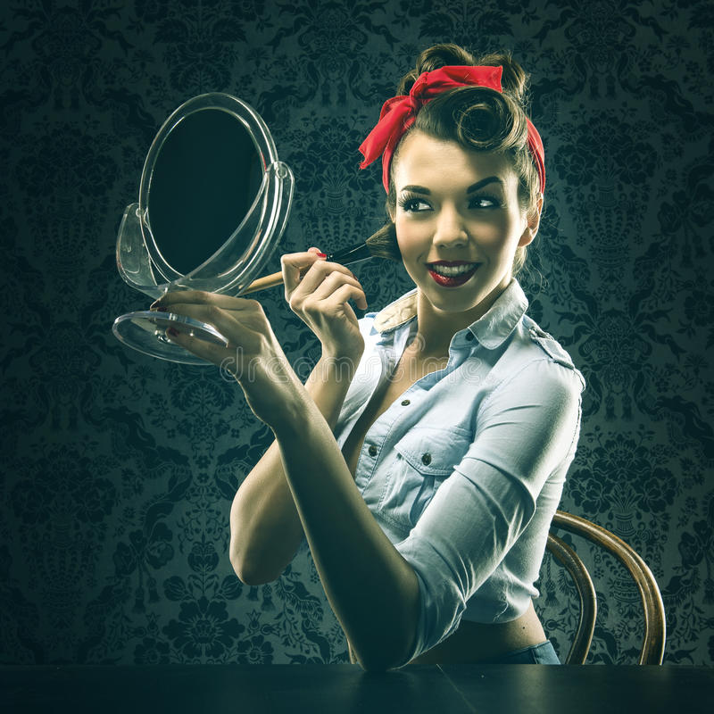 Vintage Woman Holding A Mirror And Makeup Brush Stock Photo Image