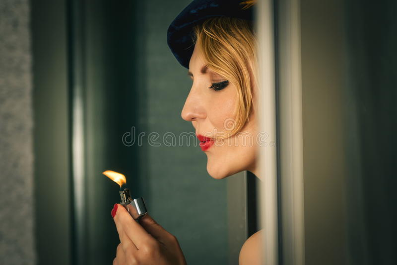 Vintage woman portrait with the lighter. Vintage woman portrait with lighter stock photo