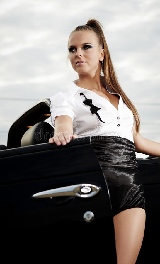 Free Vintage Woman With Cabrio Car Royalty Free Stock Photo - 21040345