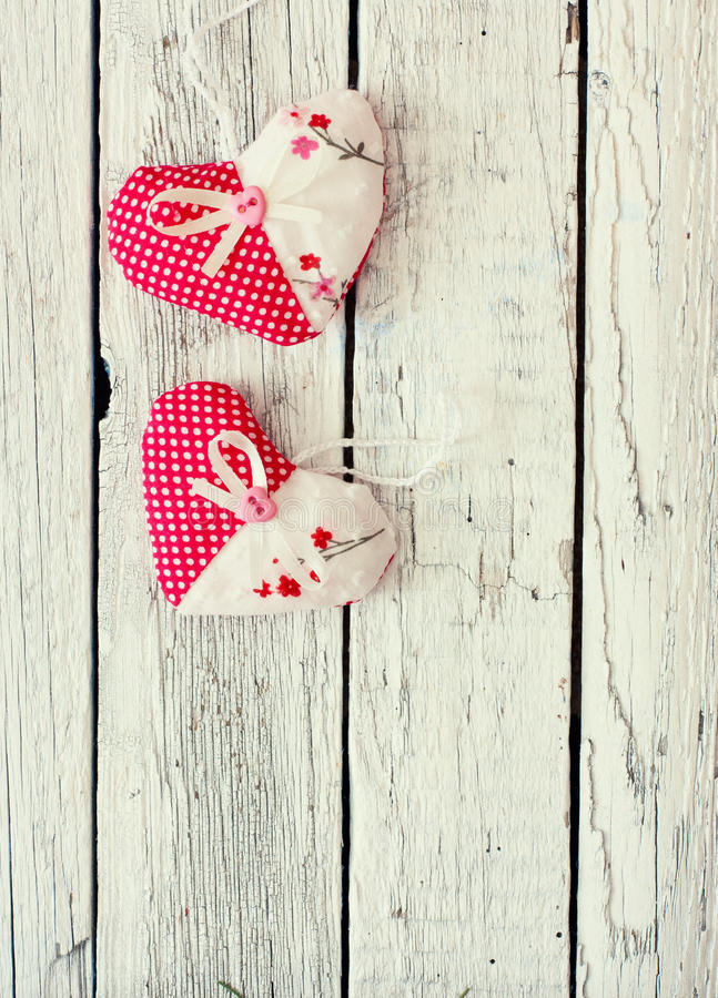 Vintage wood background with decorative hearts royalty free stock photos