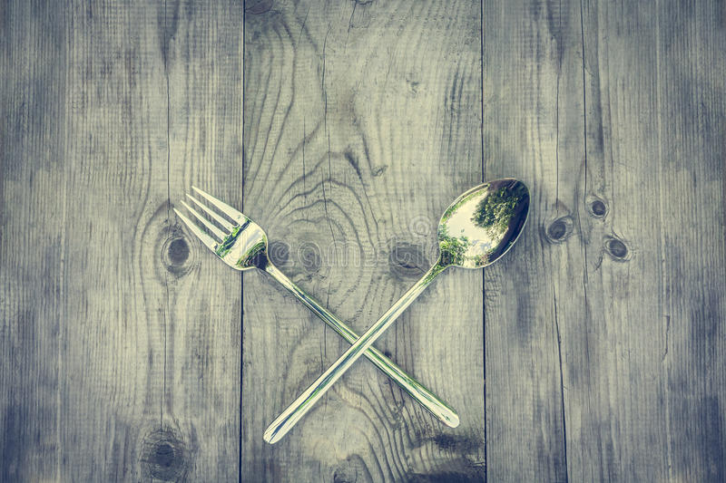 Vintage wood background with silver cutlery stock photo