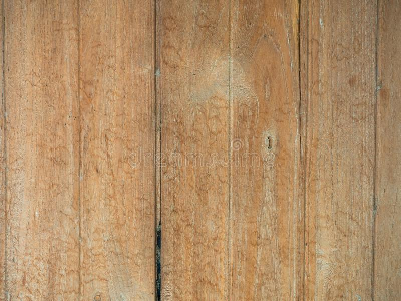 Vintage wood of background texture with knots and nail holes royalty free stock photo