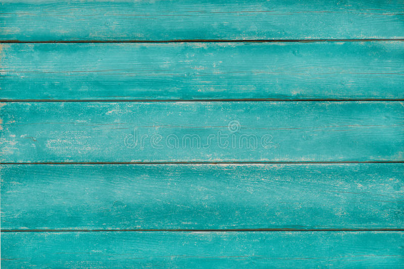 Vintage wood turquoise green background. Vintage wood painted in turquoise green color, weathered and scraped, background, copy space stock images