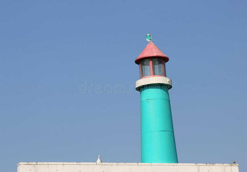 Vintage, wooden blue and pink lighthouse. stock image