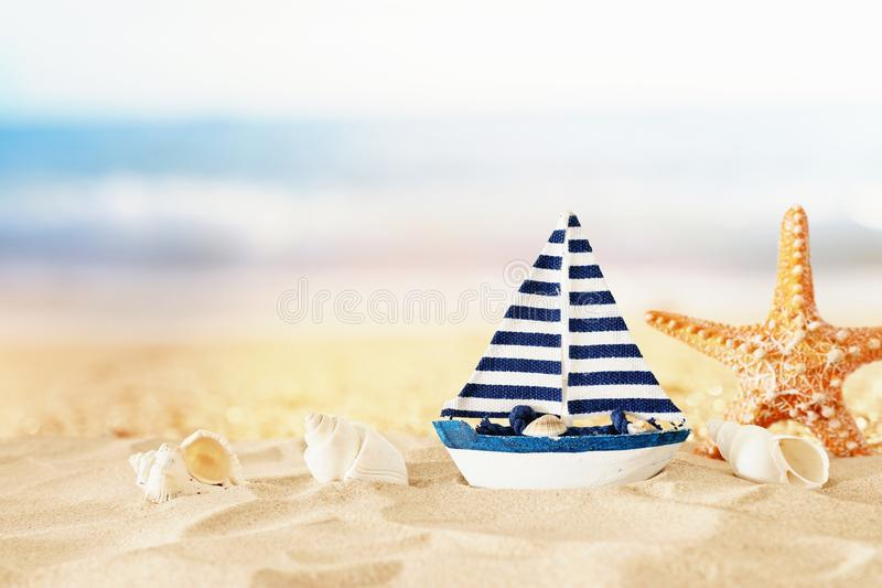 Vintage wooden boat over beach sand and sea landscape background.  royalty free stock photo
