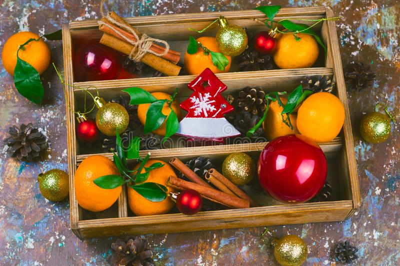 Wooden box with christmas decorations set. Vintage wooden box with christmas decorations  set royalty free stock images