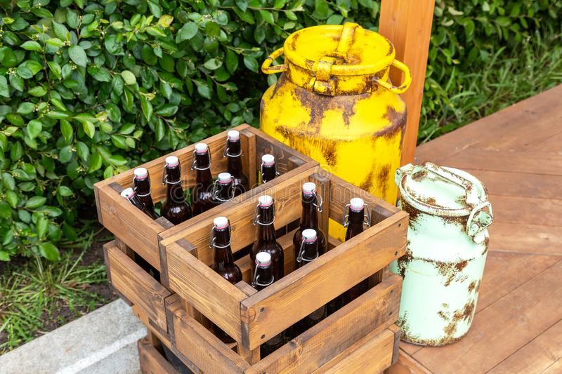 Vintage wooden boxes with craft beer bottles. And metal cans stock photo