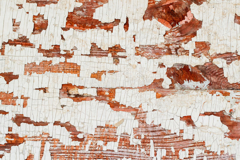 Vintage wooden brown textured background with peeling paint white color. Place for your text. Vintage wooden brown textured background with peeling paint white royalty free stock image