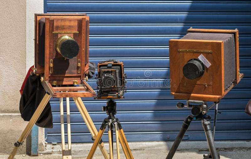 Vintage wooden cameras stand outdoor. France stock photos