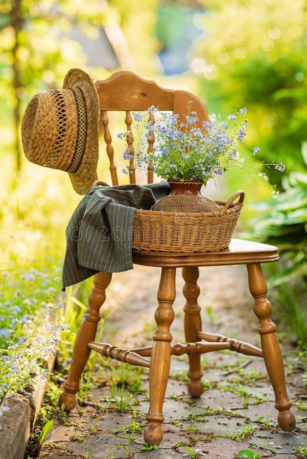 Vintage wooden chair in the garden royalty free stock images