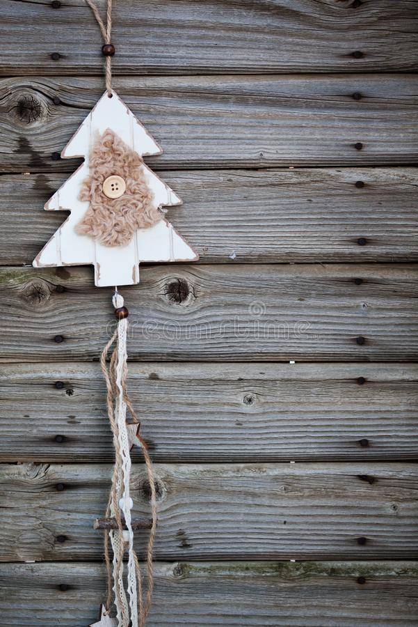 vintage wooden christmas decoration hanging - rustic holiday background stock photos