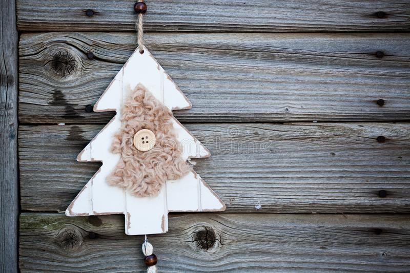 vintage wooden christmas decoration hanging - rustic holiday background royalty free stock image
