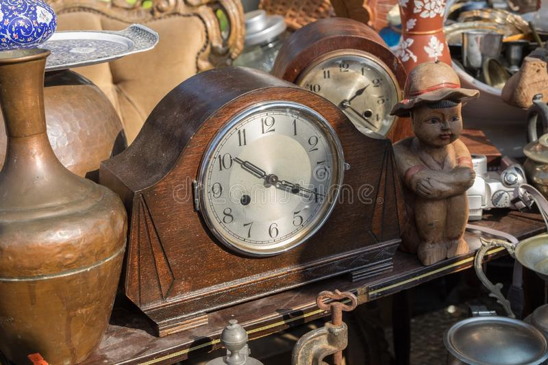 Vintage wooden clock for sale at old Jaffa Flea Market royalty free stock photos