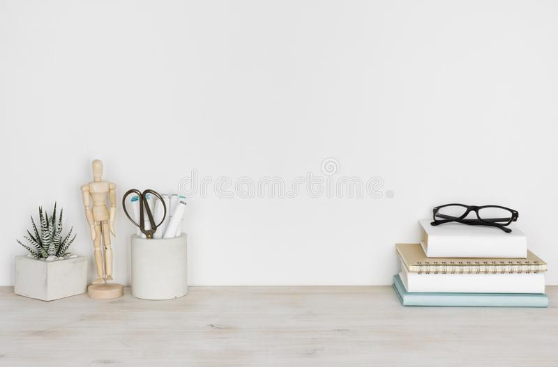 Vintage wooden desktop with books and office or school supplies royalty free stock photography