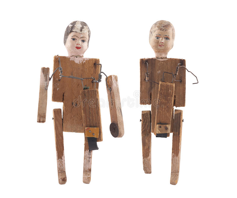 Vintage wooden dolls isolated on white background with clipping path. Vintage wooden dolls isolated on white background royalty free stock image
