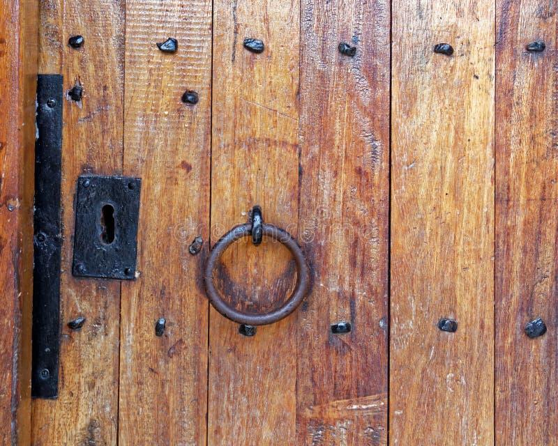Vintage wooden door with metallic handle closeup royalty free stock images