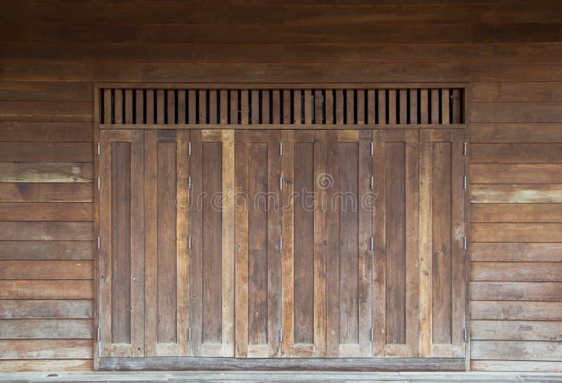 Vintage wooden folding door arkivfoto