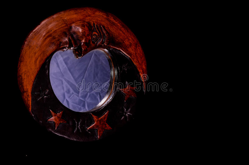 Vintage Wooden Handmade Mirror with Moon and Stars. On a Black Background stock photos