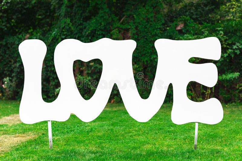 Vintage wooden inscription Love in the garden. stock images
