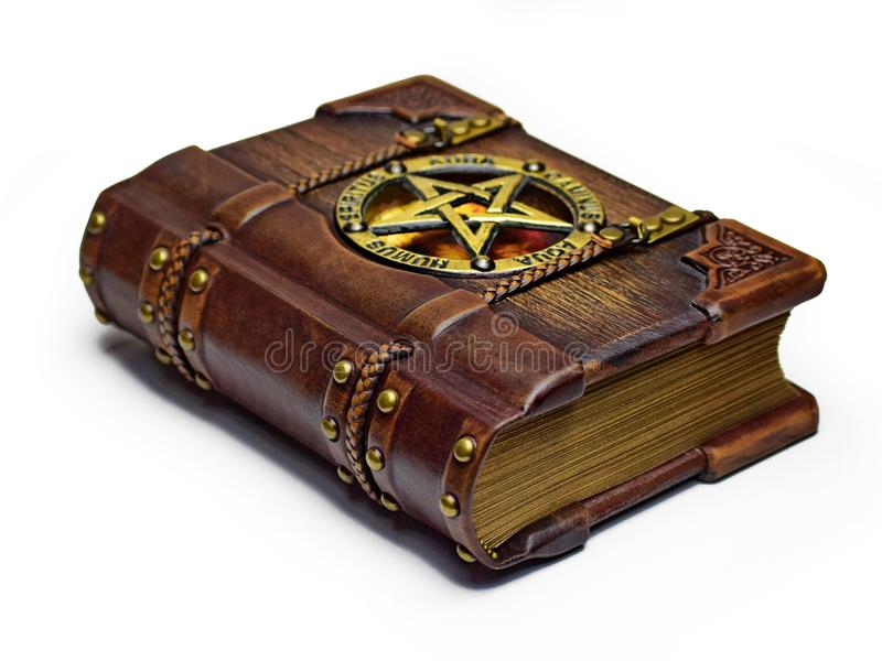 Vintage wooden - leather Grimoire book with a pentagram and Latin names of Classical elements royalty free stock photography