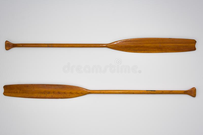 Vintage Wooden Paddle Oars Close Up on White Background. Vintage Wooden Paddle Oars Close Up on a White Background royalty free stock photos