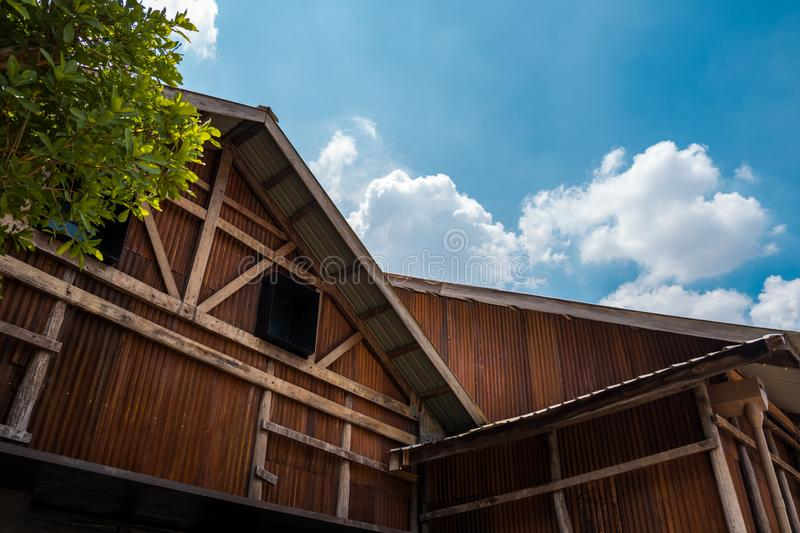 Vintage wooden and rust zinc sheets barn. royalty free stock photography