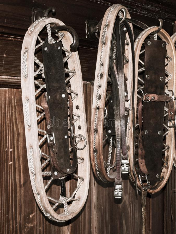 Vintage wooden snowshoes hanging on the wall in mountain cottage stock image