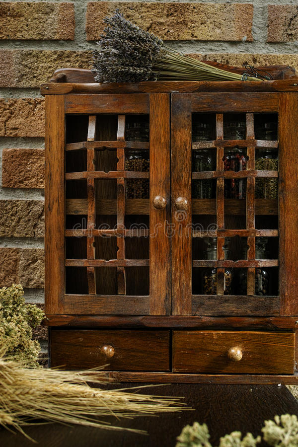 Vintage Wooden Spice Rack Or Storage Cabinet Stock Photo